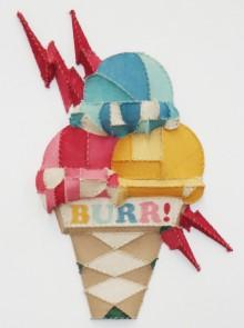 giant fabric sculpture of ice cream cone facial tattoo