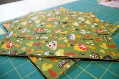 cut the fabric out 1/2 larger than the finished dimensions