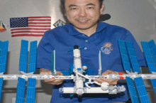astronaut builds lego space station while on the space station