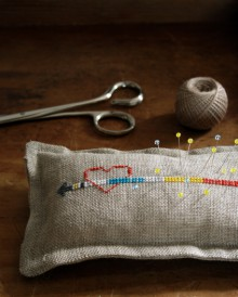 how-to: cross-stitch heart and arrow pin cushion