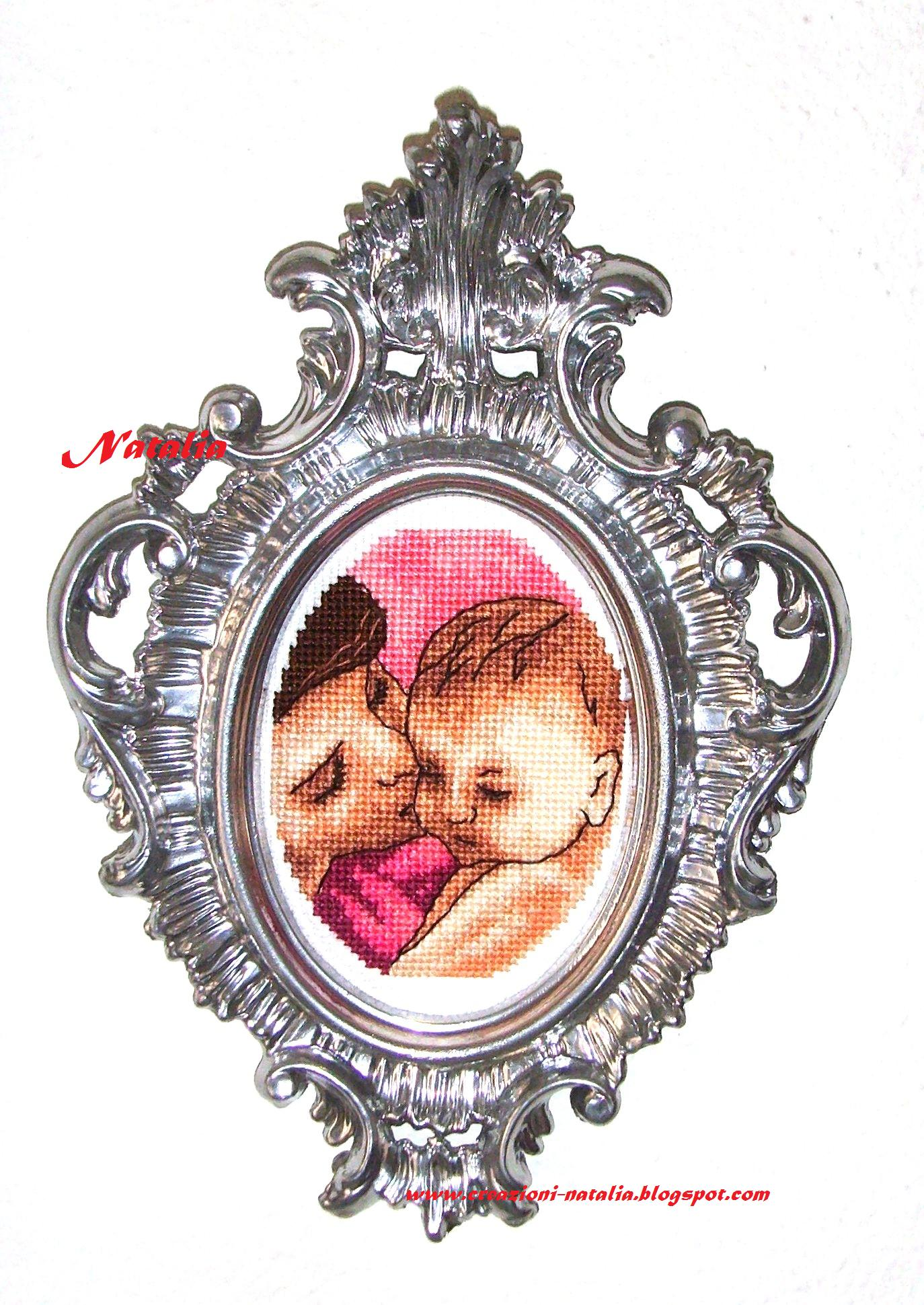 http://make-handmade.com/wp-content/uploads/2011/12/mother-day-gifts-mother-baby-cross-stitch-make-handmade-157ef4b24816d.jpg